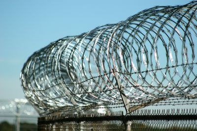 http://us.123rf.com/400wm/400/400/dbvirago/dbvirago0610/dbvirago061000096/583417-razor-wire-atop-security-fence-at-military-base.jpg